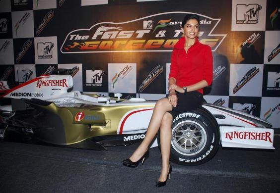 Bollywood actress Padukone poses on a Formula One car in Mumbai